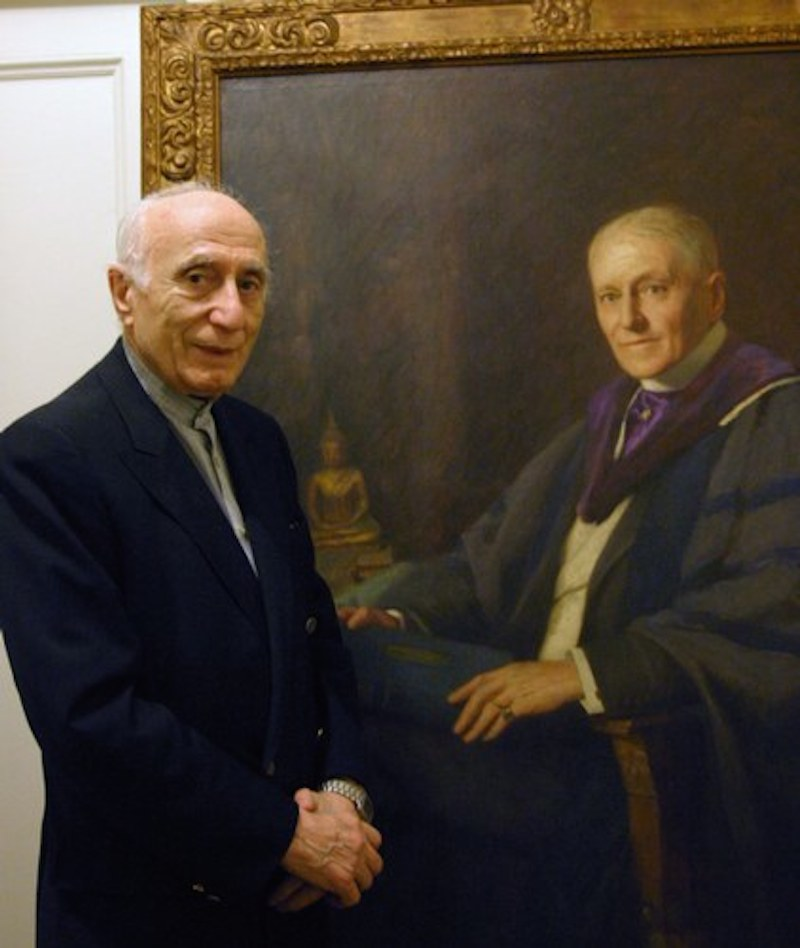 Ehsan Yarshater, the founder and director of the Encyclopedia Iranica at Columbia University, stands in front of portrait of Dr. Abraham V.W. Jackson, 1862-1937, a Professor of Indo-Iranian languages at Columbia University at the turn of the 20th century